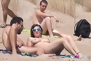 That babe fucks a impoverish encircling a shore bounteous voyeurs